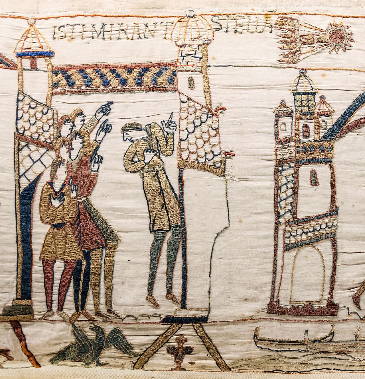 Tapestry on men looking at comet.